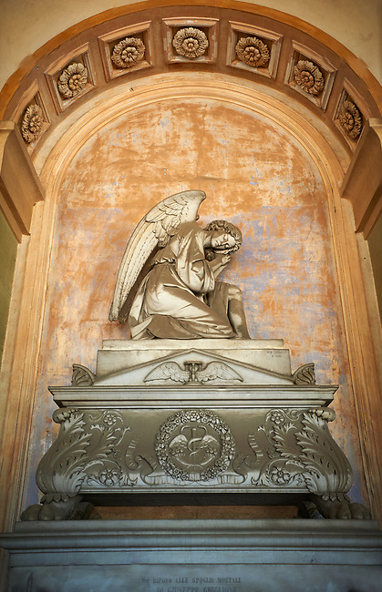 Pictures of the stone classical sculptured of an angel on a monumental tombs of Guiseppe Ghiglioni,  Staglieno Monumental Cemetery. Sculptor Giovanni Battista Cevasco 1870,  Genoa, Italy