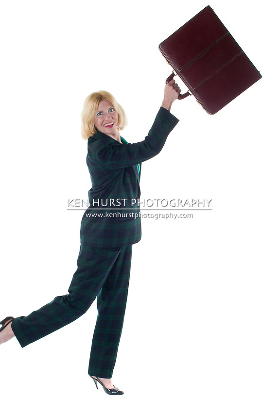 Smiling Ecstatic woman ready to throw her briefcase away after successfully completing a tough task!