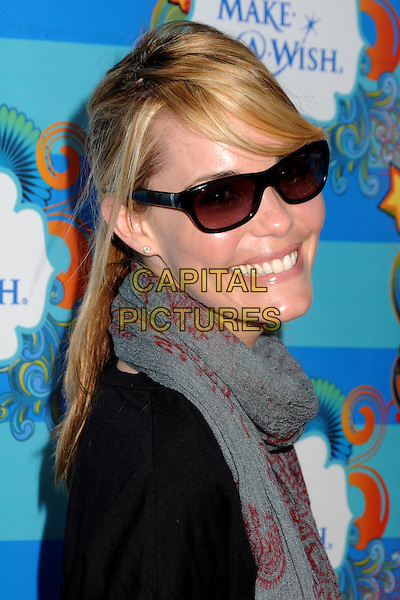 LESLIE BIBB .At the Make-A-Wish Foundation Day held at the Santa Monica Pier, Santa Monica, California, USA, .14th March 2010..portrait headshot grey gray red print scarf sunglasses black .CAP/ADM/BP.©Byron Purvis/Admedia/Capital Pictures
