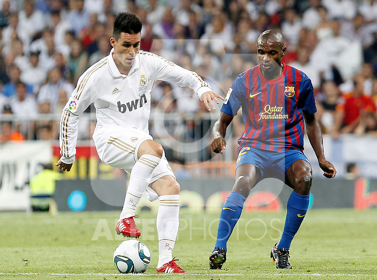 Real Madrid's Jose Maria Callejon (l) and FC Barcelona's Eric Abidal during Spanish Supercup 1st match.August 14,2011. (ALTERPHOTOS/Acero)