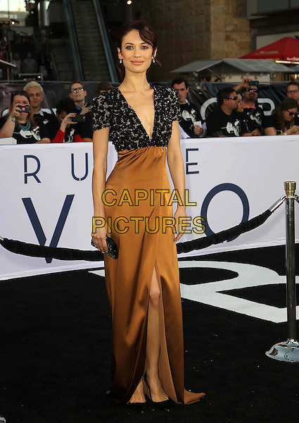 "Olga Kurylenko.""Oblivion"" Los Angeles Premiere held at the Dolby Theatre, Hollywood, California, USA..April 10th, 2013.full length top brown silk satin skirt dress black beads beaded detail clutch bag slit split .CAP/ADM/KB.©Kevan Brooks/AdMedia/Capital Pictures."