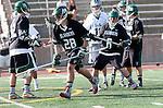 La Canada Flintridge, CA 03/16/13 - Kevin Fahey (Coronado #28) and Trent Schulte (Coronado #6) in action during the De La Salle vs Coronado lacrosse game at St Francis High School.  De La Salle defeated Coronado 8-5.