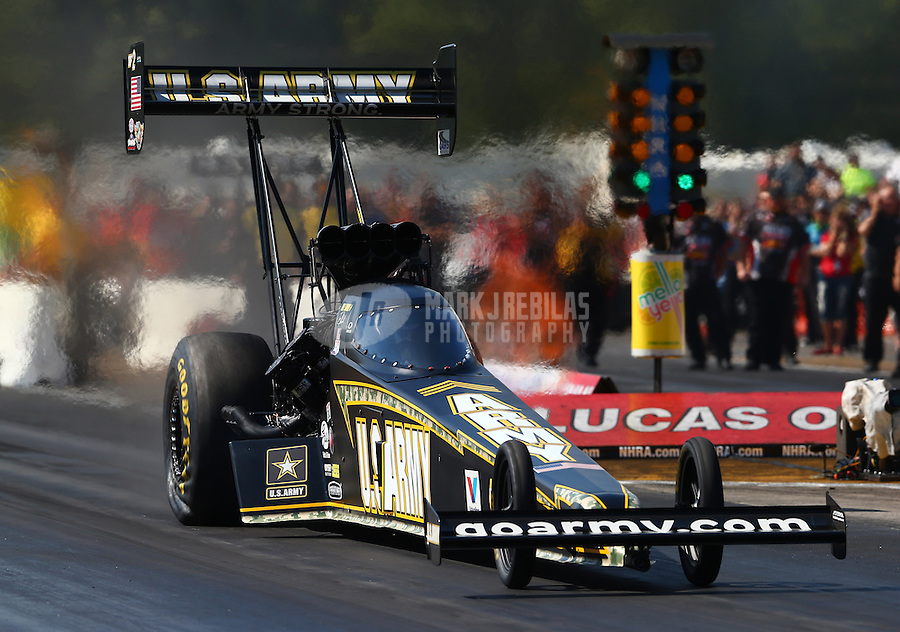 Aug. 17, 2013; Brainerd, MN, USA: NHRA top fuel dragster driver Tony Schumacher during qualifying for the Lucas Oil Nationals at Brainerd International Raceway. Mandatory Credit: Mark J. Rebilas-