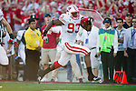 Wisconsin Badgers defensive lineman Louis Nzegwu (93) returns a fumble for a touchdown during the 2012 Rose Bowl NCAA football game against the Oregon Ducks in Pasadena, California on January 2, 2012. The Ducks won 45-38. (Photo by David Stluka)