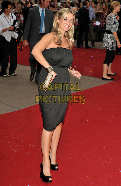 "LOUISE REDKNAPP .Red Carpet Arrivals at the ""Sex And The City"" Movie World Premiere, Odeon Leicester Square, London, England, UK,.May 12th 2008..full length black strapless dress hands on hips gold studded clutch bag black shoes.CAP/PL.©Phil Loftus/Capital Pictures"