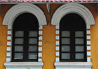 Traditional architectural Portugese design seen in the windows and arches in this old house in Goa