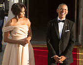 United States President Barack Obama and First Lady Michelle Obama share a light moment as they await the arrival of guests at the State Dinner while participating in the U.S.- Nordic Leaders Summit at The White House in Washington, DC, May 13, 2016.<br /> Credit: Chris Kleponis / CNP