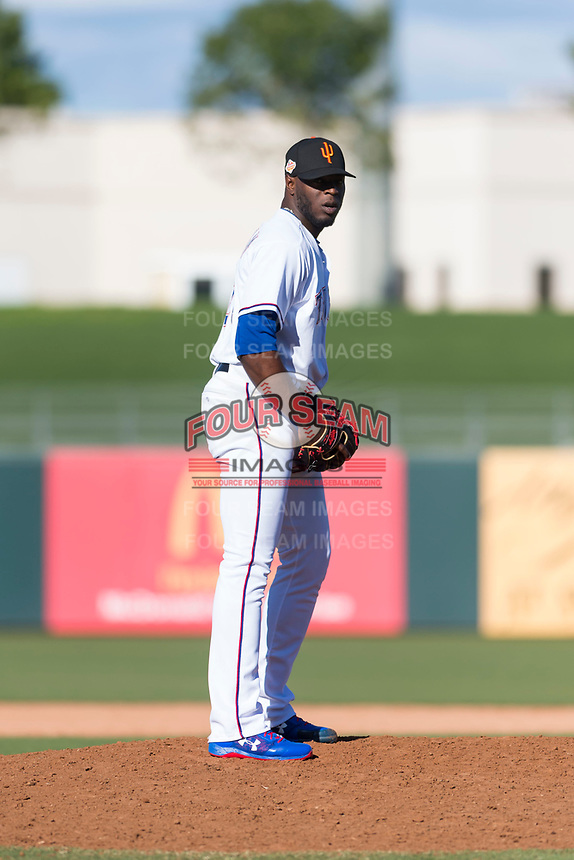 Surprise Saguaros relief pitcher C.D. Pelham (24), of the Texas Rangers organization, gets ready to deliver a pitch during an Arizona Fall League game against the Peoria Javelinas at Surprise Stadium on October 17, 2018 in Surprise, Arizona. (Zachary Lucy/Four Seam Images)