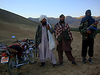 A commander and two foot sioldier from the Wardak Mobile Patrol Unit armed with an AK47 machine gun out on patrol in the mountains of wardak
