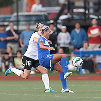 Boston Breakers forward Kyah Simon (17) passes the ball.  In a National Women's Soccer League (NWSL) match, Boston Breakers (blue) defeated Portland Thorns FC (white/black), 2-1, at Dilboy Stadium on August 7, 2013.