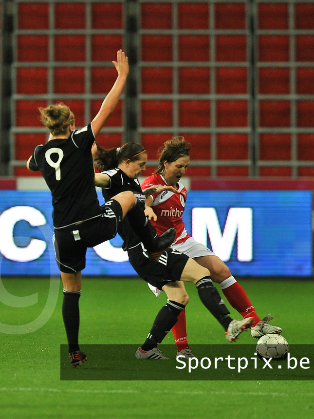 20131009 - LIEGE , BELGIUM : Standard's Maud Coutereels (right) pictured dueling with Glasgow's Suzanne Malone (middle) and Glasgow's Ruesha Littlejohn (right ) during the female soccer match between STANDARD femina de liege and GLASGOW City LFC , in the 1/16 final ( round of 32 ) first leg in the UEFA Women's Champions League 2013 in Stade Maurice Dufrasne - Sclessin in Liege . Wednesday 9 October 2013 . PHOTO JOHNY DE MEULEMEESTER