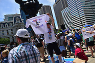 "Philadelphia, PA - July 26, 2016: A man sells t-shirts that read ""Ring in the Political Revolution at a ""Bernie or Bust"" rally across from City Hall during the Democratic National Convention in Philadelphia, PA, July 26, 2016  (Photo by Don Baxter/Media Images International)"