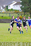 Annascaul Eamon Lenihan in possession of the ball tackled by Ardfert Brian Maloney and Darren Wallace during the Intermediate match at Annascaul GAA Grounds on Saturday evening.