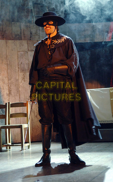 MATT RAWLE .in a scene from Zorro The Musical, based on The Mask of Zorro, Garrick Theatre, London, England, .July 9th 2007..stage photocall play costume black cape hat mask full length.CAP/WIZ.©Wizard/Capital Pictures