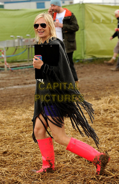 Jo Whiley.Day Two of the Glastonbury Festival at Worthy Farm, Pilton, England. .June 24th, 2011.spotted wellies wellington boots black  full length poncho pink walking side sunglasses shades .CAP/WIZ.© Wizard/Capital Pictures.