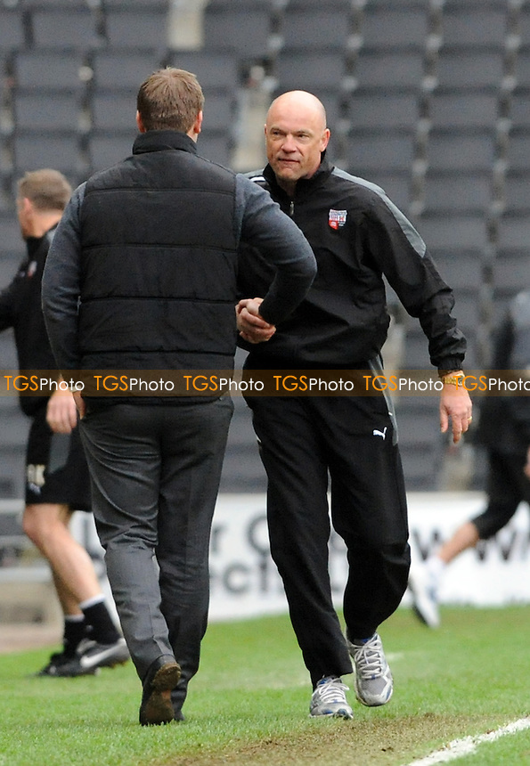 Brentford manager Uwe Rosler has words with MK Dons manager Karl Robinson at the final whistle - MK Dons vs Brentford - nPower League One Football at Stadium MK, Milton Keynes - 31/03/12 - MANDATORY CREDIT: Anne-Marie Sanderson/TGSPHOTO - Self billing applies where appropriate - 0845 094 6026 - contact@tgsphoto.co.uk - NO UNPAID USE.