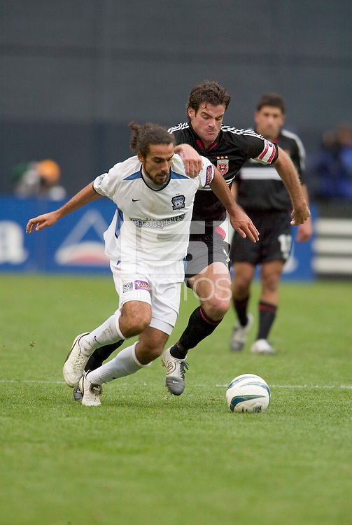 San Jose Earthquakes' Dwayne De Rosario is marked by D.C. United's Ryan Nelsen. DC United defeated the San Jose Earthquakes 2 to 1 during the MLS season opener at RFK Stadium, Washington, DC, on April 3, 2004.