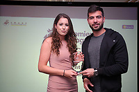 Pictured: Jordi Amat (R) presents an award to Katy Hosford Thursday 06 April 2017<br /> Re: Swansea City AFC Community Trust Celebration Event at the Liberty Stadium, Swansea, Wales, UK.