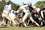 Palos Verdes, CA 10/30/09 - \MC86\, J.R. Tavai (MC# 44), Marcus Probasco (MC# 85) and Logan Okuda (#25) in action during the Mira Costa Mustang vs Peninsula Panthers football game played at Peninsula High School.