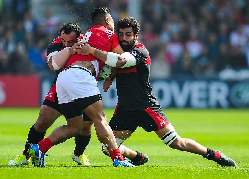 Tonga's Tane Takulua is tackled by Georgia's Davit Zirakashvili and Vito Kolelishvili<br /> <br /> Photographer Craig Thomas/CameraSport<br /> <br /> Rugby Union - 2015 Rugby World Cup - 12;00  Georgia v Tonga - Saturday 19th September 2015 - Kingsholm - Gloucester <br /> <br /> &copy; CameraSport - 43 Linden Ave. Countesthorpe. Leicester. England. LE8 5PG - Tel: +44 (0) 116 277 4147 - admin@camerasport.com - www.camerasport.com