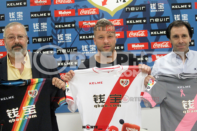 Rayo Vallecano's new player Patrick Ebert (c) withnthe General Manager Felipe Minambres (r) during his official presentation. August 04, 2015. (ALTERPHOTOS/Acero)