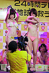 """Japanese adult movie actresses take off their clothes in front of the camera during the 12th annual 24 hour TV event """"Eroticism Saves the Earth Telethon"""" on August 30, 2014 in Tokyo, Japan. 12 Japanese actresses donated their breasts for a 24 hour telethon event with the aim of raising money for a Stop AIDS charity. The adult movie stars allowed fans to feel their breasts in return for a donation to the AIDS charity. The 12th annual 24 hour TV event """"Eroticism Saves the Earth Telethon"""" is organized by Sky Perfect Tv Adult Chanel with motto """"Social contribution while enjoying the erotic"""". Fans are given the chance to interact with some of the channels leading actresses in the live broadcast event that runs from Saturday afternoon through until Sunday 20:00 hrs. The organizers expect to attract around 2000 fans raising JPY 2 million (US$20,000) over the weekend.(Photo by Rodrigo Reyes Marin/AFLO)"""