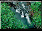Photographed from a small bridge. Waterfall in Cascade Mountains, Elkhorn, Oregon .  John leads private photo tours throughout Colorado. Year-round Colorado photo tours. .  John offers private photo tours throughout the western USA, especially Colorado. Year-round.