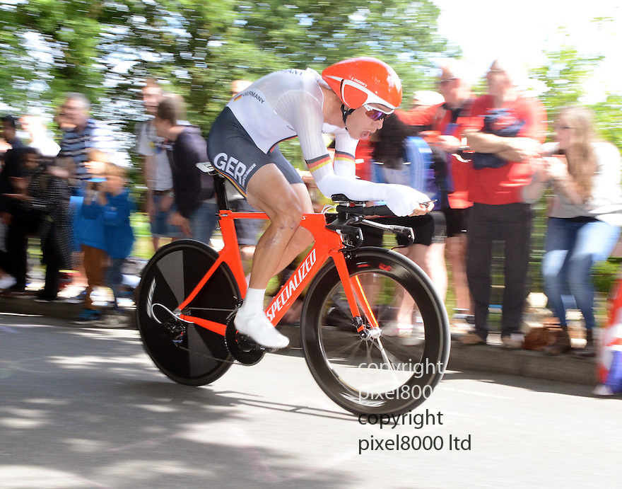 Cycling time trial Mens..German cyclist Tony Martin.Crowds on village green in Esher watch big screen as..Bradley Wiggins goes for gold in time trial today 1.8.12..they cheered the gold medal....Pic by Gavin Rodgers/Pixel 8000 Ltd