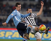 Calcio, Serie A: Lazio vs Juventus. Roma, stadio Olimpico, 4 dicembre 2015.<br /> Lazio&rsquo;s Miroslav Klose, left, is challenged by Juventus&rsquo; Giorgio Chiellini during the Italian Serie A football match between Lazio and Juventus at Rome's Olympic stadium, 4 December 2015.<br /> UPDATE IMAGES PRESS/Isabella Bonotto