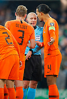 16th November 2019; Windsor Park, Belfast, Antrim County, Northern Ireland; European Championships 2020 Qualifier, Northern Ireland versus Netherlands; Referee Szymon Marciniak talks to Virgil van Dijk (c) of Netherlands after he awards Norther Ireland a penalty kick - Editorial Use