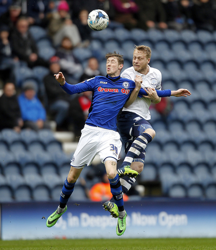 Preston North End's Tom Clarke jumps with  Rochdale's Joe Bunney<br /> <br /> Photographer Mick Walker/CameraSport<br /> <br /> Football - The Football League Sky Bet League One - Preston North End v Rochdale -  Friday 3rd April 2015 - Deepdale - Preston<br /> <br /> &copy; CameraSport - 43 Linden Ave. Countesthorpe. Leicester. England. LE8 5PG - Tel: +44 (0) 116 277 4147 - admin@camerasport.com - www.camerasport.com