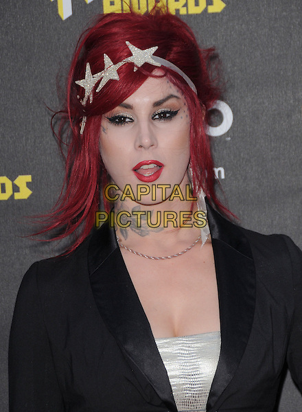 KAT VON D .at the 2010 NewNowNext Awards held at The Edison in Los Angeles, California, USA, June 8th, 2010..portrait headshot dyed red hair make-up lipstick mouth open black  jacket tattoos  stars star hairband hair band headband                                                                  .CAP/RKE/DVS.©DVS/RockinExposures/Capital Pictures.