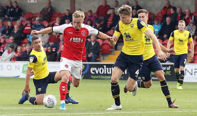 Fleetwood Town's Kyle Dempsey under pressure from Oxford United's Rob Dickie<br /> <br /> Photographer Rich Linley/CameraSport<br /> <br /> The EFL Sky Bet League One - Fleetwood Town v Oxford United - Saturday 7th September 2019 - Highbury Stadium - Fleetwood<br /> <br /> World Copyright © 2019 CameraSport. All rights reserved. 43 Linden Ave. Countesthorpe. Leicester. England. LE8 5PG - Tel: +44 (0) 116 277 4147 - admin@camerasport.com - www.camerasport.com