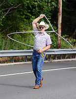 Wrangler Rick Deacon of Levittown, Pennsylvania twirls his rope during the Middletown Township 4th of July Independence Day Parade Monday July 4, 2016 in Middletown Township, Pennsylvania. (Photo by William Thomas Cain)