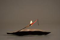 A lit incense stick