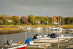 Inlet with boats and homes in autumn. Clinton, CT.