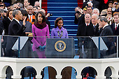 United States President Barack Obama takes the oath of office from Chief Justice John Roberts at the ceremonial swearing-in at the U.S. Capitol during the 57th Presidential Inauguration in Washington, Monday, January 21, 2013.  .Credit: Scott Andrews / Pool via CNP