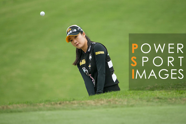 Ji Hyun Oh of South Korea chips into the 12th green during Round 2 of the World Ladies Championship 2016 on 11 March 2016 at Mission Hills Olazabal Golf Course in Dongguan, China. Photo by Victor Fraile / Power Sport Images