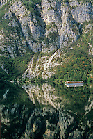 Tour boat cruising on Lake Bohinj, mirror-like reflection of mountains, Triglav National Park, Slovenia, AGPix_0560   .