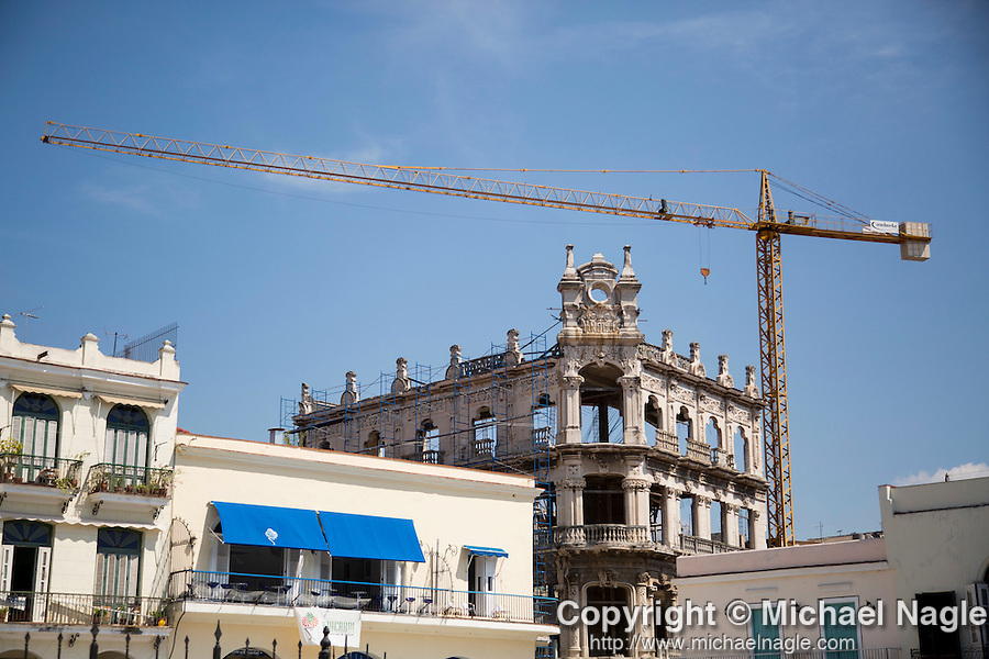 HAVANA, CUBA -- MARCH 23, 2015:  A crane stands above a building renovation in the Havana Vieja neighborhood in Havana, Cuba on March 23, 2015. Photograph by Michael Nagle