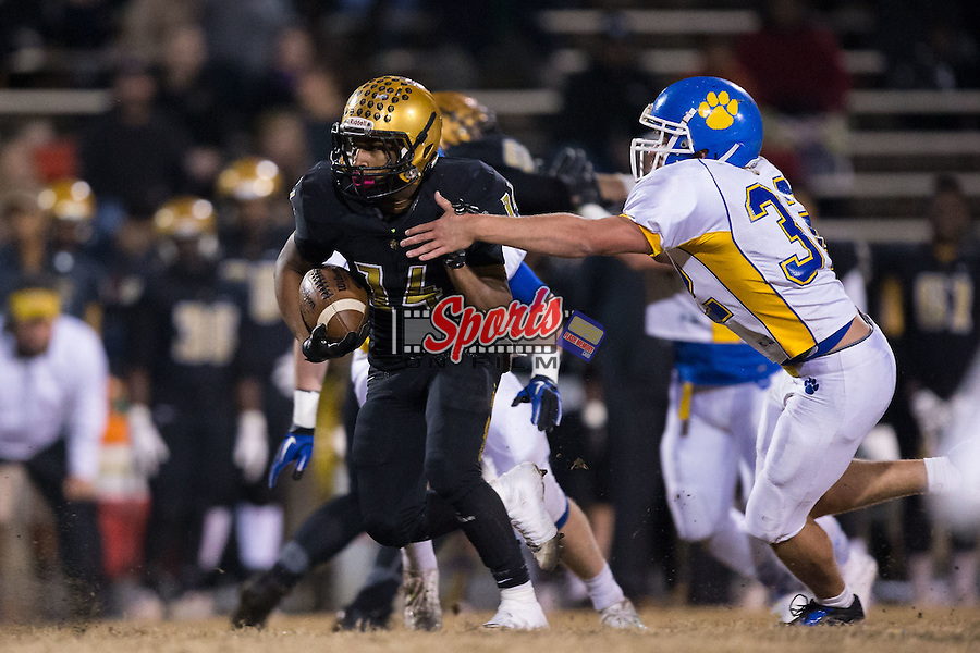 Xavier Brooks (14) of the Shelby Golden Lions tries to avoid being tackled by Dakota Wensil (32) of the Mount Pleasant Tigers during first half action at George Blanton Memorial Stadium November 27, 2015, in Shelby, North Carolina.  The Golden Lions defeated the Tigers 38-27.  (Brian Westerholt/Sports On Film)