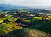 Sunlight shining on Valley in Tuscany, Italy