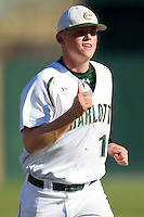 Justin Seager #10 of the Charlotte 49ers warms up in the outfield prior to the game against the Missouri Tigers at Robert and Mariam Hayes Stadium on February 25, 2011 in Charlotte, North Carolina.  Photo by Brian Westerholt / Four Seam Images