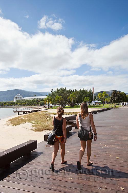 Tourists walking along the Esplanade boardwalk.  Cairns, Queensland, Australia