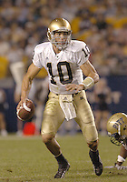 3 September 2005:  Notre Dame QB Brady Quinn (10) scrambles away from a Pitt defender.  Notre Dame defeated Pittsburgh 42-21 September 3, 2005 at Heinz Field in Pittsburgh, PA..