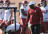 NWA Democrat-Gazette/ANDY SHUPE<br /> Arkansas assistant coach John Scott Jr. directs his players Tuesday, March 28, 2017, during spring practice at the UA practice facility in Fayetteville.