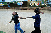 KLIPRIVER, SOUTH AFRICA APRIL 14: Leah Mokgabudi, age 6, (L) plays with her friend Bongani Speelman, age 7, on the schoolyard during a morning break from classes on April 14, 2003 at Sibonile (means: we have seen) School for the Blind in Klipriver, south of Johannesburg, South Africa. A blind woman founded the school in 1994. The school has about 125 students from disadvantaged communities around South Africa. Many of the children have faced rejection from their families and communities, and at Sibonile they have a chance for a good education. (Photo: Per-Anders Pettersson)..