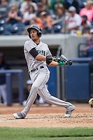 Dayton Dragons outfielder Jose Siri (15) follows through on his swing against the West Michigan Whitecaps on April 24, 2016 at Fifth Third Ballpark in Comstock, Michigan. Dayton defeated West Michigan 4-3. (Andrew Woolley/Four Seam Images)