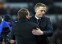 SWANSEA, WALES - MARCH 16: Swansea manager Garry Monk (R) embraces Liverpool manager Brendan Rodgers (L) after  the Premier League match between Swansea City and Liverpool at the Liberty Stadium on March 16, 2015 in Swansea, Wales