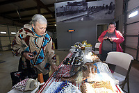 NWA Democrat-Gazette/FLIP PUTTHOFF<br /> WINTER FARMERS MARKET<br /> Linda Woods (left) looks Saturday Jan. 6 2017 at tote bags made by Sara Paschal (right), a vendor at the winter Rogers Farmers Market in downtown Rogers. The market is open on Saturdays from 10 a.m. to 2 p.m. through April at First and Cherry streets. Summer hours of 8 a.m. to 1 p.m. on Saturdays resume in May, said Mary Christine Neal, market manager. This is the inaugural season for the winter market, Neal said.